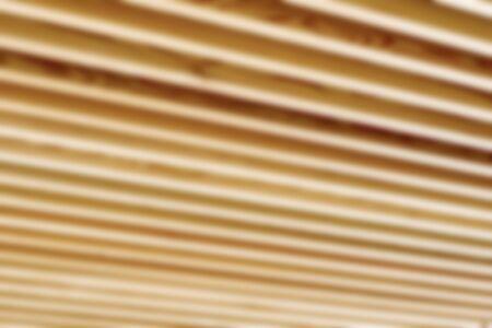 defocussed: Blurred or defocused close up of wooden joist ceiling of commercial building