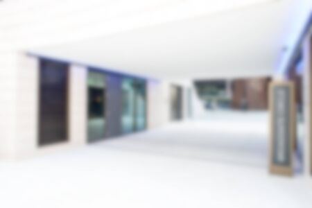 brightly lit: Brightly lit blurred background of office corridor