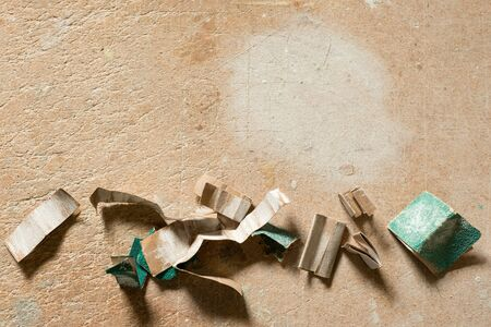 sandpaper: Pieces of used sandpaper on work wooden surface with copy space.