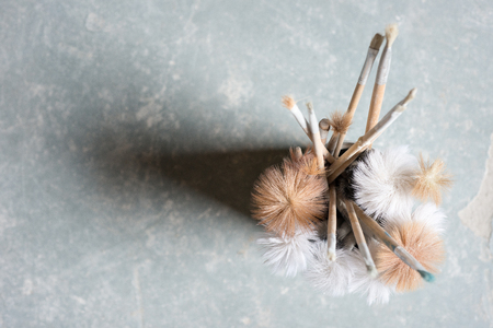 bristles: Overhead view of paintbrushes in a holder on stone surface, overlooking bristles with copy space Stock Photo