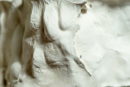 hardened: Caking or hardening plaster for abstract or backgrounds.