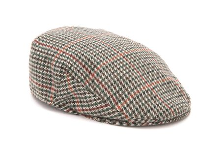 Cutout of a houndstooh tweed hunting hat or flat cap. Stock Photo
