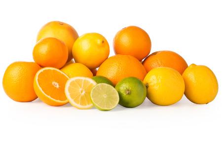 ascorbic acid: Cutout of a collection of citrus fruits including oranges, lemons, grapefruit, and lime plus slices.