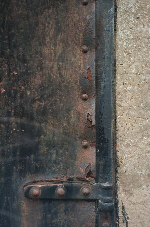 stile: Hinge and stile section of an old, rusted iron door