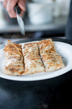 batters: Cooked crepe in paper plate sliced into three equal sizes using a knife