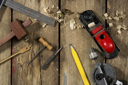 auger: Old woodworking tools. Tools include a bradle, punch, gauge, ruler, drill and drill bit an auger and wood plane Stock Photo