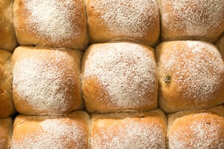 A cluster of newly-baked bread buns for abstract or backgrounds