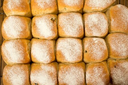 Overhead of a cluster of newly-baked bread buns for abstract or backgrounds