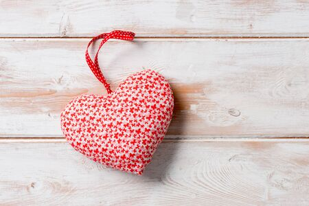 Red heart-shaped stuffed decoration with copy space for Valentines Day and other romatic occassions Stock Photo