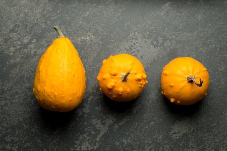 bumpy: Overhead shot of three yellow bumpy gourd Stock Photo