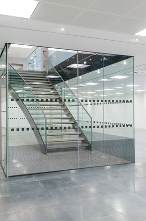 Staircase in glass lobby