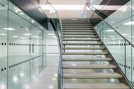 Metal staircase in modern open plan office building Foto de archivo
