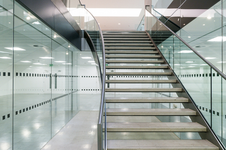 Metal staircase in modern open plan office building Archivio Fotografico