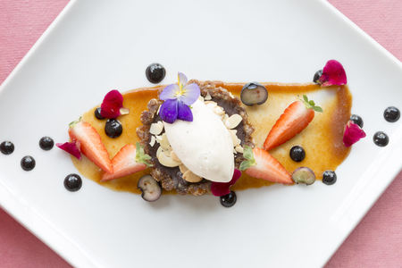 ganache: Ganache tart with sliced strawberries on syrup Stock Photo