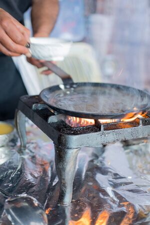 dosa: Smoking hot dosa skillet on stove Stock Photo