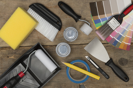 Overhead shot of home improvement painting equipment on a wooden background Stock Photo