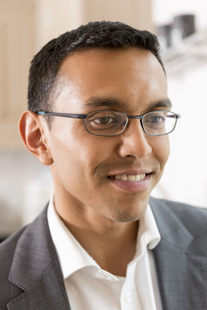 Closeup portrait of young man in eyeglasses and business garb Stock Photo