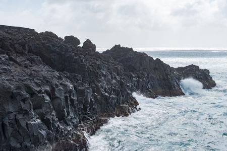 View of rock formation and sea with crashing waves, Los Hervideros, Lanzarote