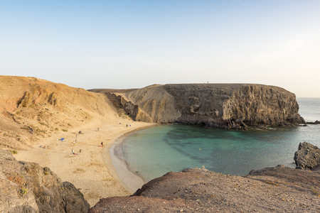 Wideangle shot of the main Papagayo beach, Lanzarote from the top looking down with people and calm water