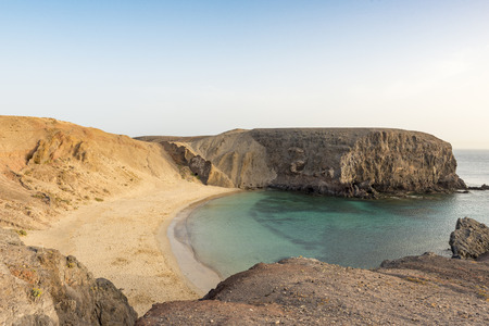 Wideangle shot of the main Papagayo beach, Lanzarote from the top looking down with no people and calm water
