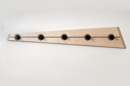 Five peg modern wooden clothes hanger on a white background