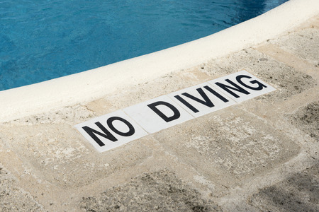 No Diving sign along the edge of a swimming pool