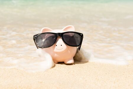 Piggy bank on the beach, blanketed in sea water
