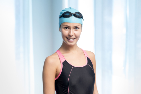 Portrait of a young lady in complete swimming gear