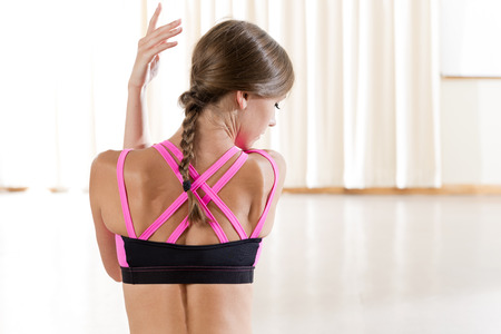 Rear view of a pink-strapped fitness bra worn by a lady with copy space Reklamní fotografie