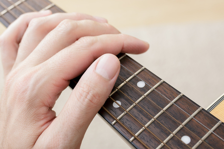 Close Up of a hand on a guitar fingerboard