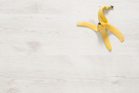 Banana peel on white wooden surface for backgrounds Imagens