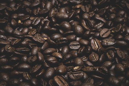 Dark roasted coffee beans for backgrounds