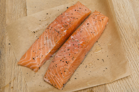 Two salmon slices seasoned with pepper