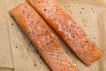 Two salmon slices sprinkled with black pepper