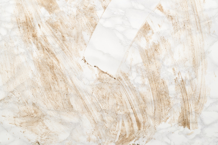 Dirty gray marble surface with a portion wiped clean
