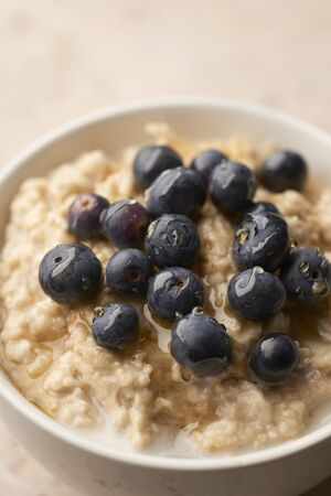 Closeup of a bowl of porright with blueberries on top