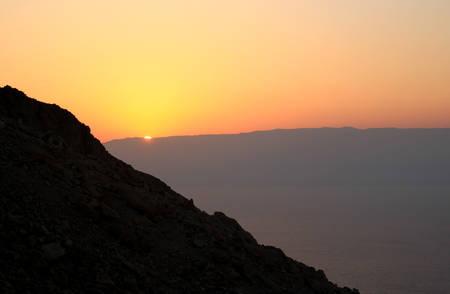 rising dead: The Sun is rising over the Dead Sea.