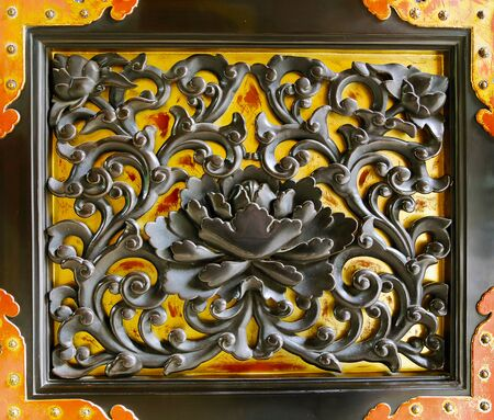 buddhist temple: Black Lotus on Gold Door Decoration at a Buddhist Temple.