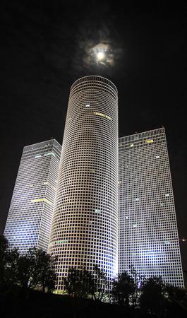 azrieli tower: Azrieli Towers in Tel Aviv at night with moon