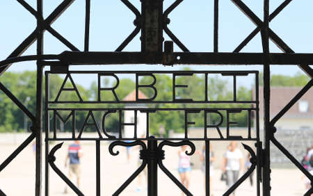 extermination: Arbeit Mach Frei (work liberates) sign at Dachau camp, Germany.