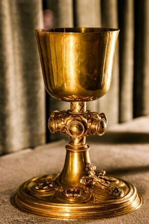 chalice: Golden holy chalice on gray background Stock Photo