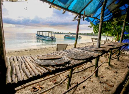 Abandoned merchant stands on an ocean shore.