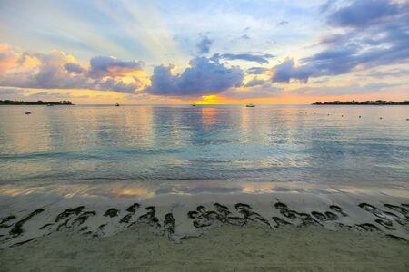 Beautiful Caribbean sunset on a beach resort.