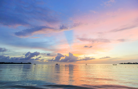 Purple and pink sea sunset on the beach, Carribean.