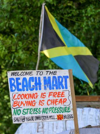 jamaican flag: Jamaican flag at a beach market with sign.