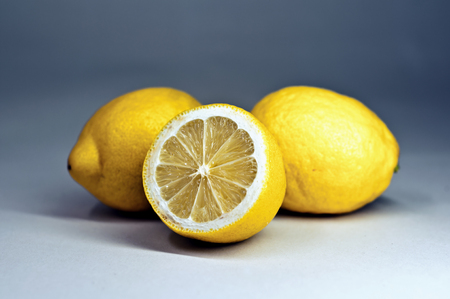 Three yellow lemons on the table Stock Photo