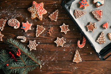 ginger biscuit and christmas decoration on dark wood background. soft light. Stock Photo
