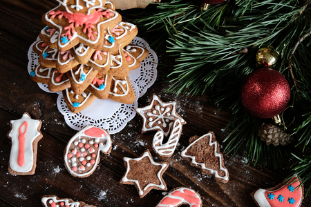 ginger biscuit and christmas decoration on dark wood background. soft light Stock Photo