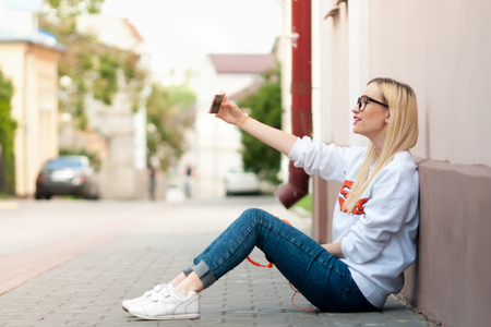 young beauty american girl make selfie, fashion model, pretty girl, outdoor portrait, hipster, lips red, make up, beauty street photo, outdoors