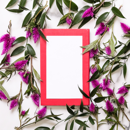 Flowers, notebook and clean postcard. Flat lay style. Top view. Marble background Stock Photo